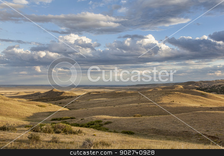 rolling prairie in Colorado stock photo, sunset illuminates the rolling prairie at foothills of Rocky Mountains in Colorado - Soapstone Open Space near Fort Collins by Marek Uliasz