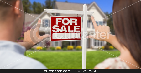 For Sale Sign, House and Military Couple Framing Hands stock photo, For Sale Real Estate Sign, House and Military Couple Framing Hands in Front. by Andy Dean
