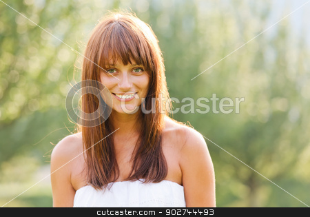 Summer portrait of young smiling woman stock photo, Summer portrait of young smiling woman against green natural background by Natalia Macheda