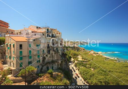 Architecture in Tropea stock photo, Tropean architecture in rustic fortress style against beautiful azure sea by Natalia Macheda