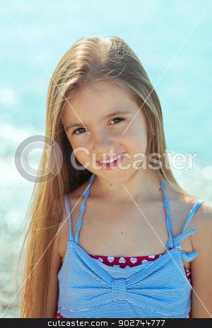 Beautiful little girl near the sea stock photo, Beautiful little girl enjoying sun near the sea by Natalia Macheda