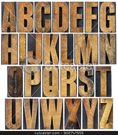 vintage wood type alphabet stock photo, complete English alphabet - a collage of 26 isolated vintage wood letterpress printing blocks, scratched and stained by ink by Marek Uliasz