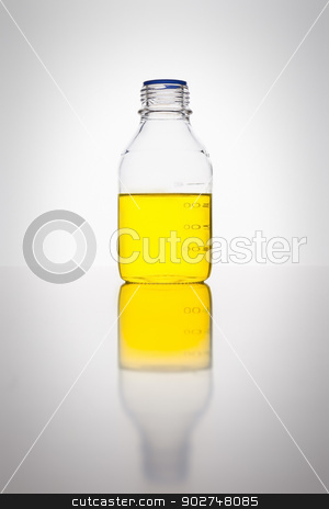 Laboratory glass bottle stock photo, A glass bottle with yellow liquid in a laboratory by Markus Gann