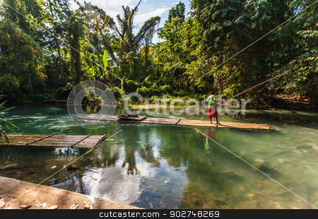 Captain Steering Bamboo Boat stock photo, River Boat and Captain on Martha Brae River in Jamaica by Scott Griessel