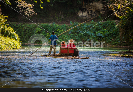 Tourists on Martha Brae River in Jamaica stock photo, River Boat with tourists on Martha Brae River in Jamaica by Scott Griessel