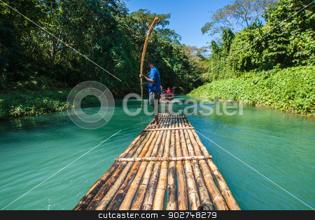 Bamboo River Tourism in Jamaica stock photo, River Boat and Captain on Martha Brae River in Jamaica by Scott Griessel