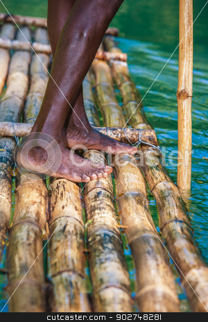 Captain's On Bamboo Boat stock photo, Feet of River Boat and Captain on Martha Brae River in Jamaica by Scott Griessel