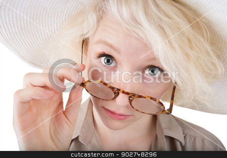 Skeptical Blond Female stock photo, Skeptical blond female looking over eyeglasses on isolated background by Scott Griessel
