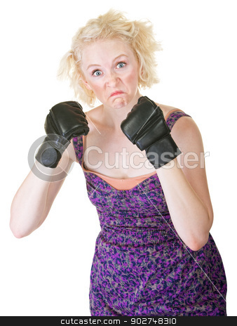 Grimacing Lady with MMA Gloves stock photo, Funny European female holding up fists on isolated background by Scott Griessel