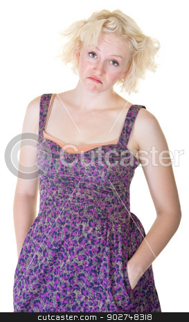 Disappointed Young Blond Woman stock photo, Disappointed female in dress with hands in pockets by Scott Griessel