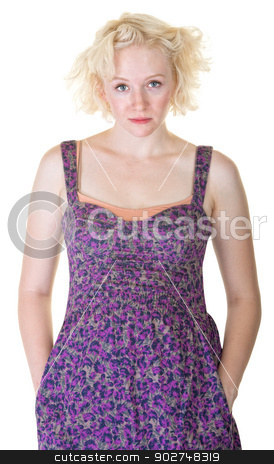 Female with Hands in Pockets stock photo, Serious blond woman in purple with hands in pockets by Scott Griessel