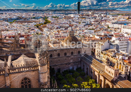 City View from Giralda Tower Seville Cathedral Garden Bull Ring  stock photo, Cityscape, City View, from Giralda Spire, Bell Tower, Orange Garden, Seville Cathedral, Andalusia Spain.  Built in the 1500s.  Largest Gothic Cathedral in the World and Third Largest Church in the World.  Bull Ring in distance. by William Perry