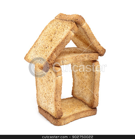 House of bread stock photo, House shape made of slices of bread on a white background. by Sinisa Botas
