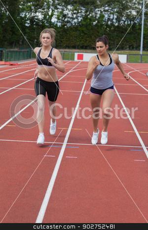 Women running a race stock photo, Women running a race on the race track by Wavebreak Media