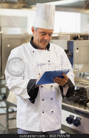 Chef using his digital tablet stock photo, Chef using his digital tablet in the kitchen by Wavebreak Media