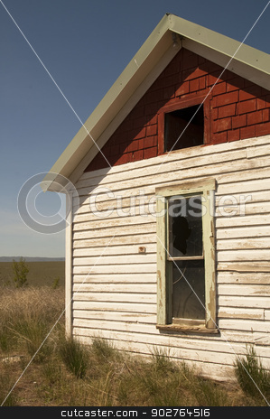 Abandoned Farm House Ghost Homestead Remains Agricultural Field stock photo, An abandoned farm house uses up valuable farm land by Christopher Boswell