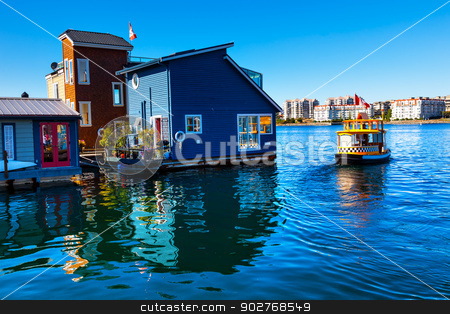Floating Home Village Water Taxi Blue Houseboats Fisherman's Wha stock photo, Floating Home Village Blue Houseboats Water Taxi Fisherman's Wharf Reflection Inner Harbor, Victoria Vancouver British Columbia Canada Pacific Northwest.  Close to the center of Victoria, this area has floating homes, boats, piers, and restuarants.  by William Perry