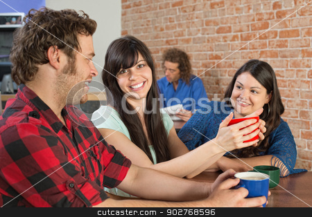 Coffee House Trio stock photo, Happy trio sitting inside of a coffee house by Scott Griessel