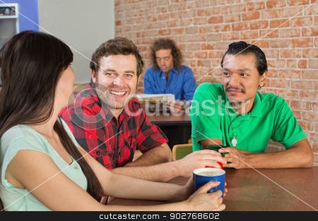 Man Drinking Coffee with Friends stock photo, Asian man drinking coffee with Caucasian friends in cafe by Scott Griessel