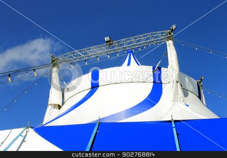 Top of circus tent stock photo, Top of blue and white circus tent, sky background. by Martin Crowdy