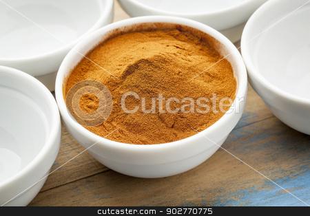 mangosteen fruit powder stock photo, raw organic dried mangosteen fruit powder in a small ceramic bowl by Marek Uliasz