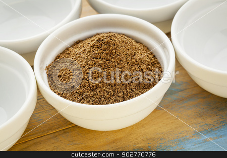 noni fruit powder  stock photo, raw organic dried noni (Morinda citrifolia,)  fruit powder in a small ceramic bowl by Marek Uliasz