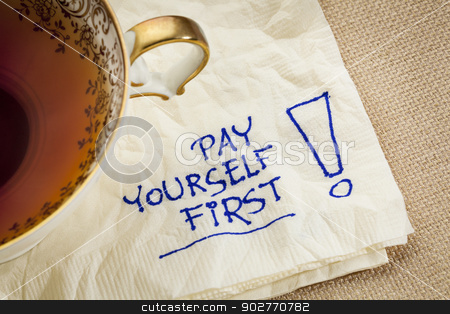 pay yourself first - advice stock photo, pay yourself first, a reminder of personal finance strategy - a napkin doodle with a tea cup by Marek Uliasz