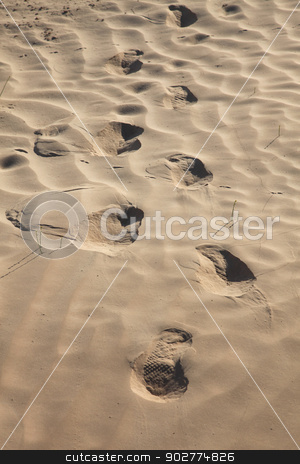 Human trace of a foot on yellow sand stock photo,  by Zvonimir Atletic