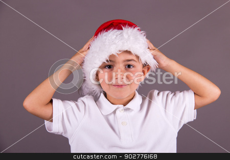 Little boy with Christmas hat stock photo, Little boy with Christmas hat by Click Images