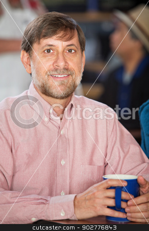 Handsome Male with Mug stock photo, Handsome mature white male holding coffee mug by Scott Griessel