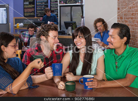 Friends in a Cafe Chatting stock photo, Diverse group of people chatting in a bistro by Scott Griessel