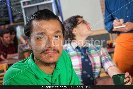 Handsome Asian Man in Cafe stock photo, Handsome young Asian man in a coffee house by Scott Griessel