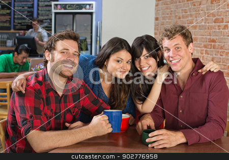 Smiling Couples in Cafe stock photo, Smiling boyfriends and girlfriends together in cafe by Scott Griessel