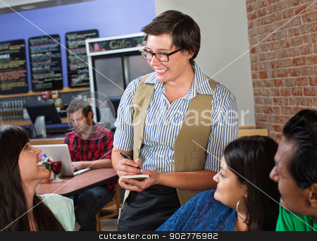 Cheerful Waitress Taking Orders stock photo, Cheerful waitress taking an order from customers by Scott Griessel