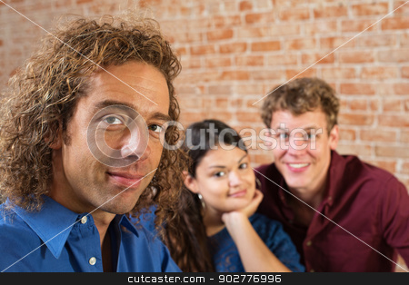 Three Young Adult Friends stock photo, Three young friends sitting together indoors by Scott Griessel