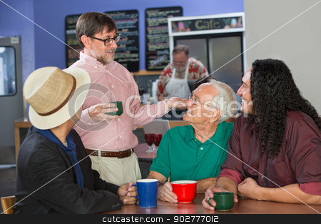 Group of Men Talking stock photo, Group of adults in restaurant talking to each other by Scott Griessel