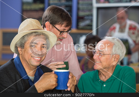 Handsome Mature Men in Bistro stock photo, Diverse trio of adult men in bistro by Scott Griessel