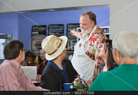 Server Helping Customers stock photo, Friendly cafe owner helping customer with menu by Scott Griessel