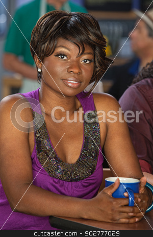 Gorgeous Woman with Coffee stock photo, Gorgeous Black woman in cafe with coffee mug by Scott Griessel