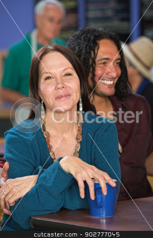 Happy Mixed Couple in Bistro stock photo, Happy white and Mexican couple sitting in cafe by Scott Griessel