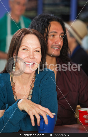 Smiling Woman with Man in Cafe stock photo, Smiling European woman with Latino man in cafe by Scott Griessel