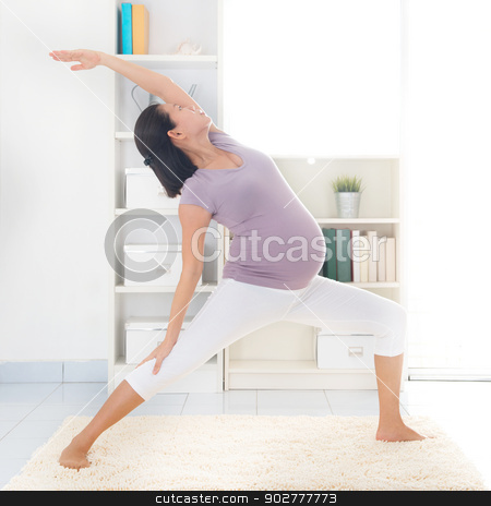 Maternal yoga. stock photo, Prenatal yoga class. Full length healthy 8 months pregnant calm Asian woman meditating or doing yoga exercise at home. Relaxation and stretching. by szefei