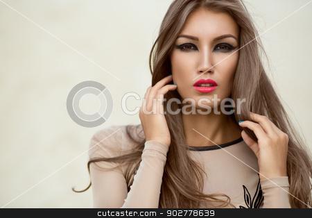 Portrait of a beautiful girl stock photo, Portrait of very beautiful girl on a light background by Artem Zolotaryov