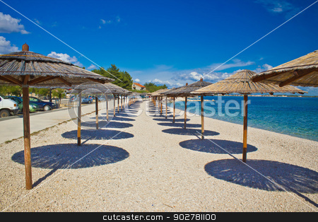 Island of Vir beach umbrellas stock photo, Island of Vir beach umbrellas, Dalmatia, croatia by xbrchx
