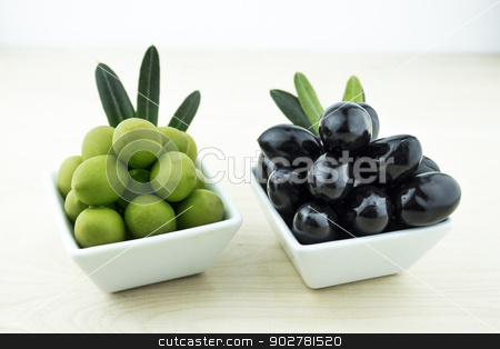 Black and Green Olives  stock photo, Black and Green Olives with leaves on a white background by Designsstock