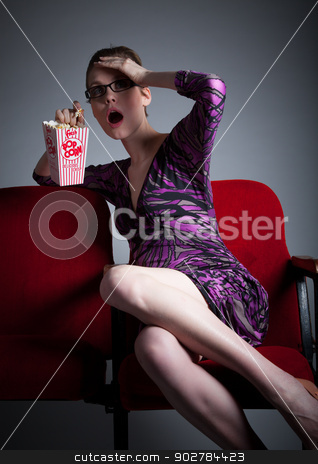 Attractive caucasian girl in her 30 shot in studio stock photo, Attractive caucasian woman in the theatre in her 30 isolated on a grey background by Bruno Monteny