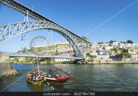 dom luis bridge porto portugal stock photo, dom luis bridge and rabelo boats in porto portugal by travelphotography