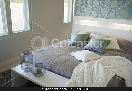 Bedroom stock photo, Contemporary small bedroom interior decor. by Stocksnapper
