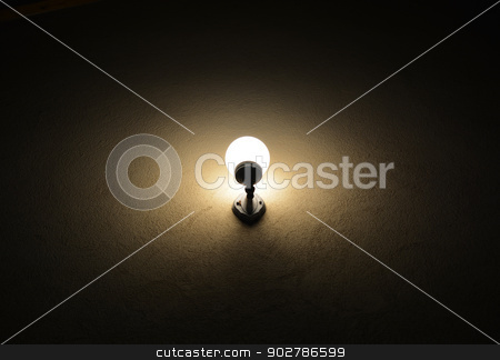 Light Bulb stock photo, a vintage light bulb on dark wall by itsh