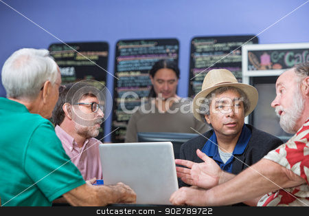Man Talking with Friends in Cafe stock photo, Man gesturing while talking with friends in cafe by Scott Griessel